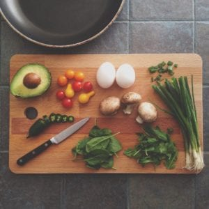 Cutting board with sliced vegetables